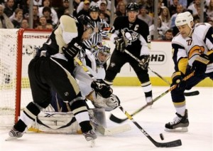 Pittsburgh Penguins' Petr Sykora, left, of the Czech Republic can't get to a rebound off  Buffalo Sabres goalie Ryan Miller, center, in the second period of a NHL hockey game in Pittsburgh Monday, Dec. 8, 2008. At right is Sabres defenseman Teppo Numminen (27) of Finland. The Sabres won 4-3. (AP Photo/Gene J. Puskar)