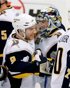 Buffalo Sabres goalie Ryan Miller, right, is congratulated by teammate Derek Roy after a 4-3 win over the Pittsburgh Penguins in a NHL hockey game in Pittsburgh on Monday, Dec. 8, 2008. (AP Photo/Gene J. Puskar)