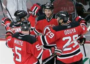 New Jersey Devils' Travis Zajac, center, celebrates his goal with teammates Jamie Langenbrunner, Colin White (5) and John Oduya (29) of Sweden in the second period against the Pittsburgh Penguins during an NHL hockey game at Prudential Center in Newark, N.J. Wednesday, Dec. 10, 2008. (AP Photo/Rich Schultz)