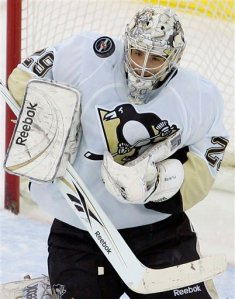 Pittsburgh Penguins' goalie Marc-Andre Fleury (29) makes a save against the New Jersey Devils in the first period during an NHL hockey game at Prudential Center in Newark, N.J., Friday, Dec. 26, 2008. (AP Photo/Rich Schultz)