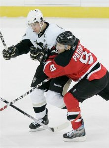 Pittsburgh Penguins' Sidney Crosby (87) is shoved by New Jersey Devils' Zach Parise (9) in the second period during an NHL hockey game at Prudential Center in Newark, N.J. Wednesday, Dec. 10, 2008. The Devils defeated the Penguins 4-1. (AP Photo/Rich Schultz)