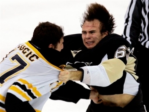 Pittsburgh Penguins' Tim Wallace, right, fights with Boston Bruins' Milan Lucic during the third period. (AP Photo/Gene J. Puskar)