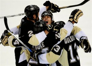 Pittsburgh Penguins' Evgeni Malkin, top center, of Russia celebrates teammate Matt Cooke's first period goal against the Anaheim Ducks during a NHL hockey game in Pittsburgh on Friday, Jan. 16, 2009.(AP Photo/Gene J. Puskar)
