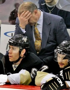 Pittsburgh Penguins coach Michel Therrien reacts to the final goal scored by the Boston Bruins in an NHL hockey game in Pittsburgh on Tuesday, Dec. 30, 2008. The Bruins won 5-2. At left on bench is Pascal Dupuis, and at right is Petr Sykora, of the Czech Republic. (AP Photo/Gene J. Puskar)