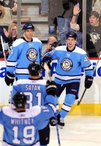 Pittsburgh Penguin's Tyler Kennedy, right, celebrates after scoring a goal in the first period of an NHL hockey game against the New York Rangers at Mellon Arena in Pittsburgh, Sunday, Jan. 18, 2009. (AP Photo/John Heller)