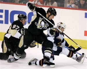 Pittsburgh Penguins' Sidney Crosby (87) and Jordan Staal, center, battle with  Atlanta Thrashers' Ron Hainsey in the third period of an NHL hockey game in Pittsburgh Tuesday, Jan. 6, 2009. The Penguins won 3-1. (AP Photo/Gene J. Puskar)