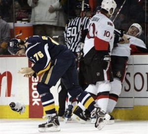 Buffalo Sabres' Jason Peters (76) looks at his hand after he was bit through the glove by Ottawa Senators' Jarkko Ruutu, right, of Finland, during a fight in the first period of an NHL hockey game at HSBC Arena in Buffalo, N.Y., Tuesday, Jan. 6, 2009. (AP Photo/David Duprey)